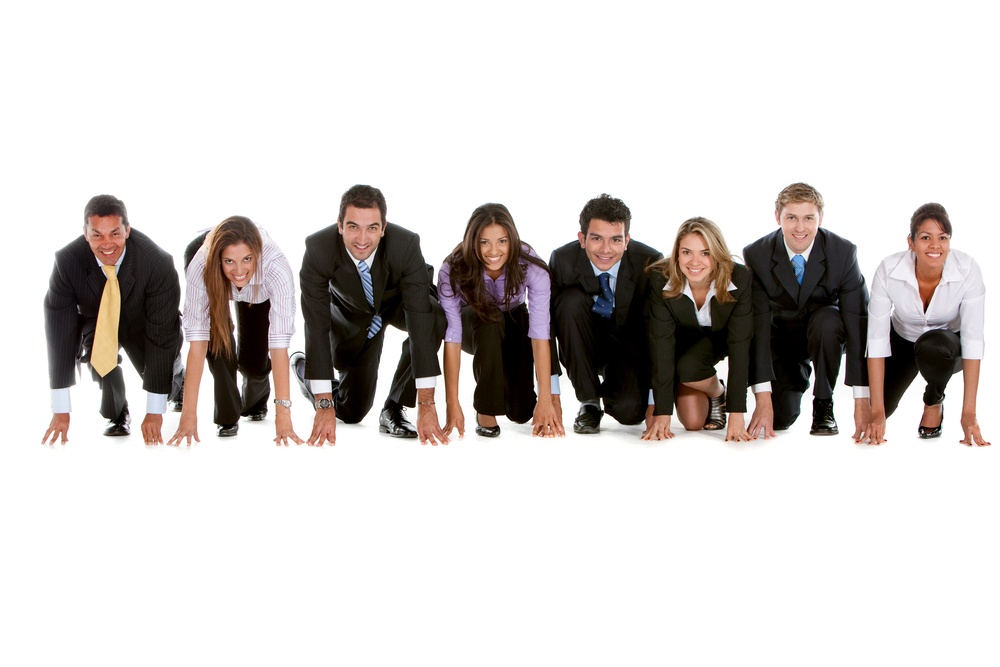 Business people ready to compete in a race isolated