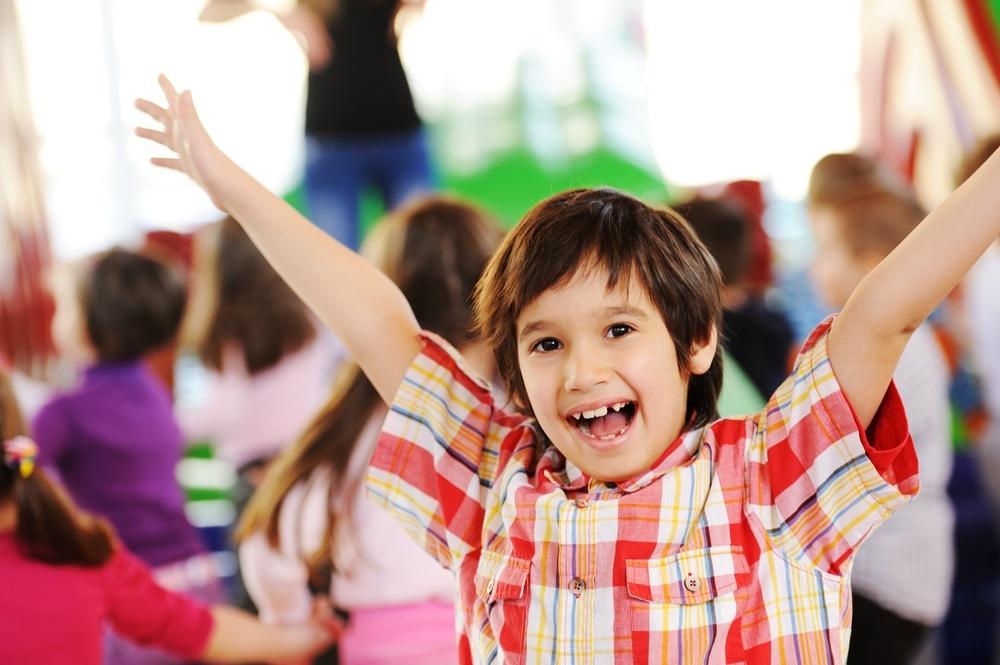 Children playing on colorful kindergarten playground.jpeg