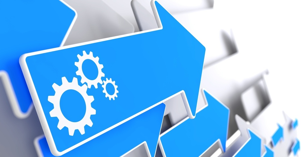 Cogwheel Gear Mechanism Icon on Blue Arrow on a Grey Background.-1