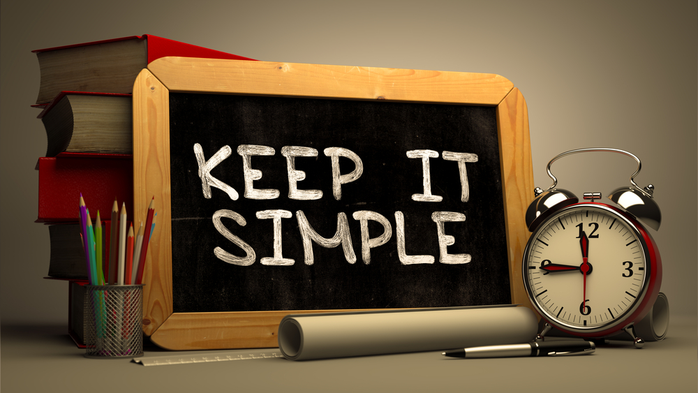Hand Drawn Keep It Simple Concept  on Chalkboard. Blurred Background. Toned Image.-1