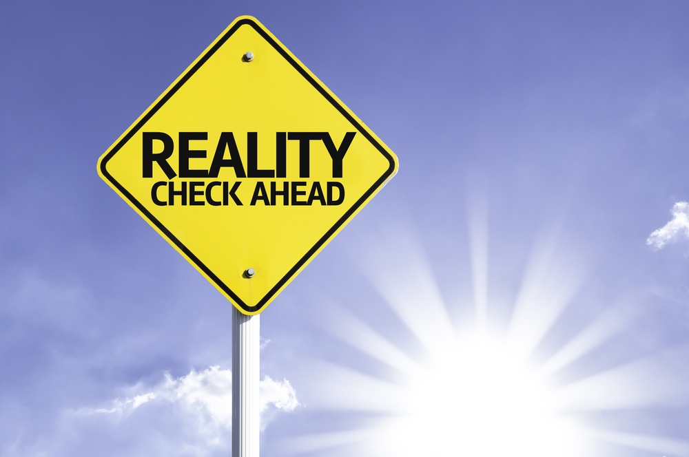 Reality Check Ahead road sign with sun background-1