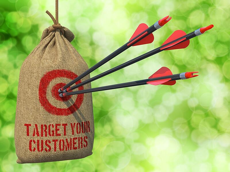 Target Your Customers - Three Arrows Hit in Red Target on a Hanging Sack on Green Bokeh Background.-1