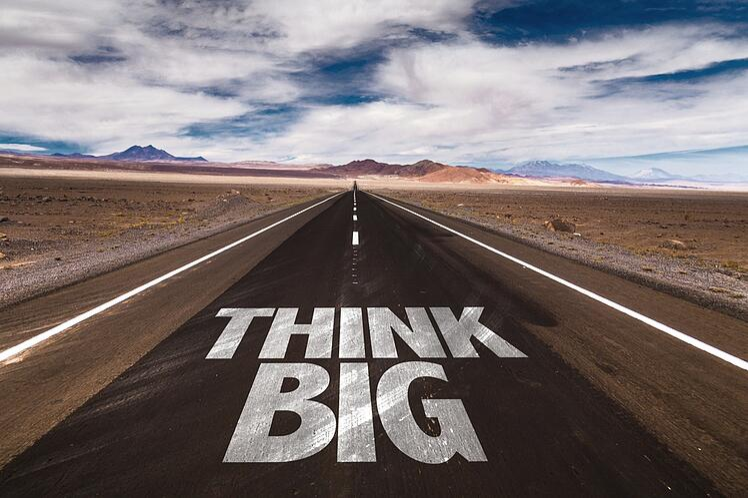 Think Big written on desert road.jpeg