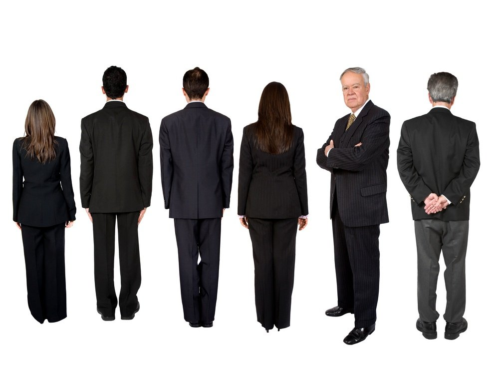 business people in a series with a senior boss standing facing the camera