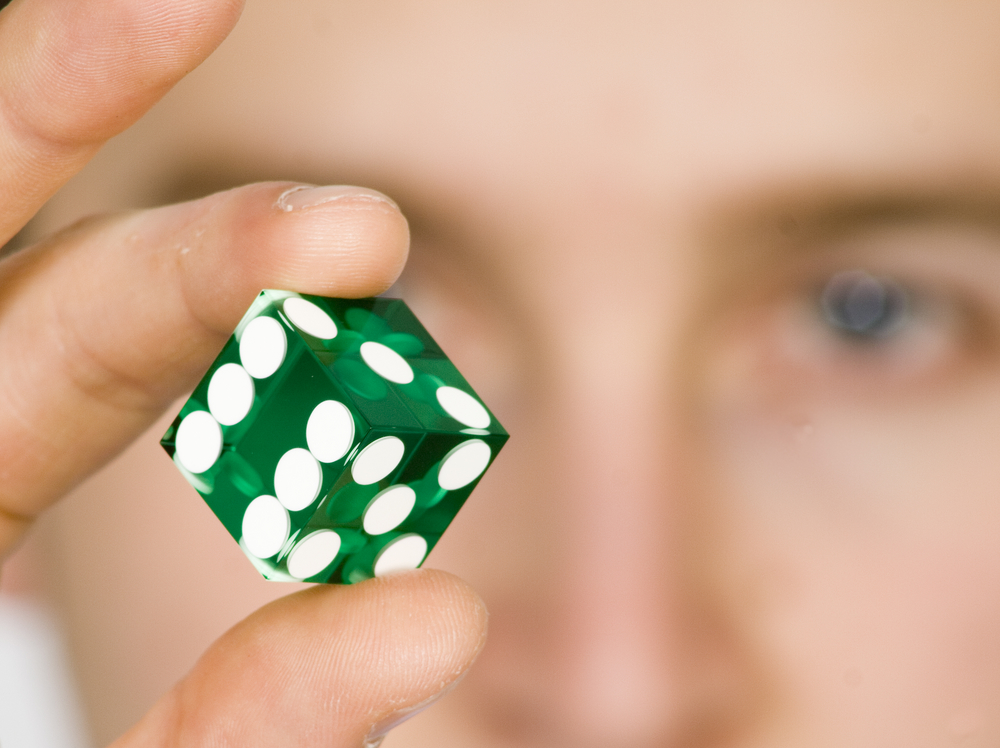 gambling dice with face on background