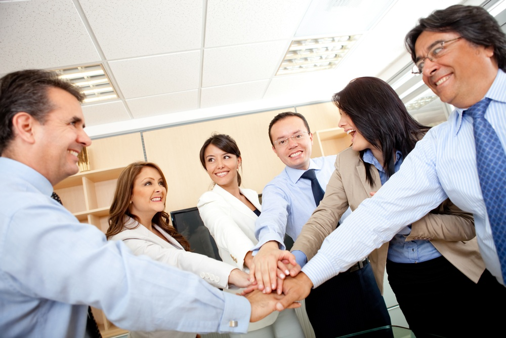 Business group with hands together in the middle - teamwork concepts.jpeg