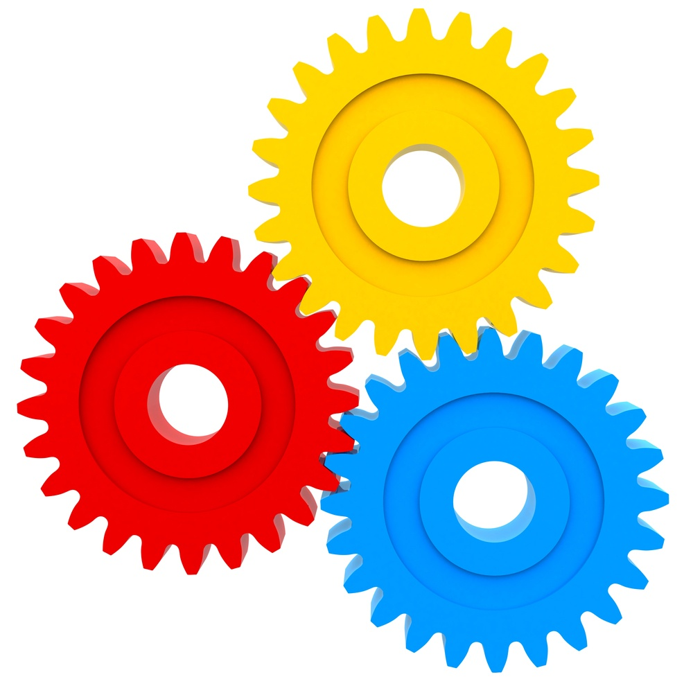 Colorful cogwheels - isolated over a white background.jpeg