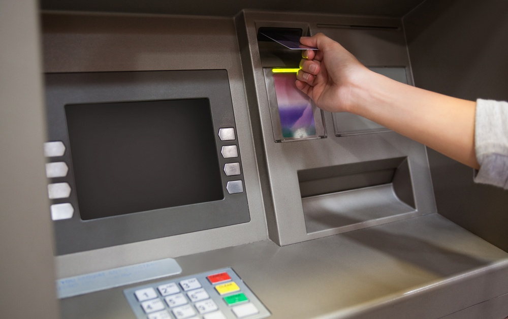 Hand inserting a credit card in an ATM.jpeg