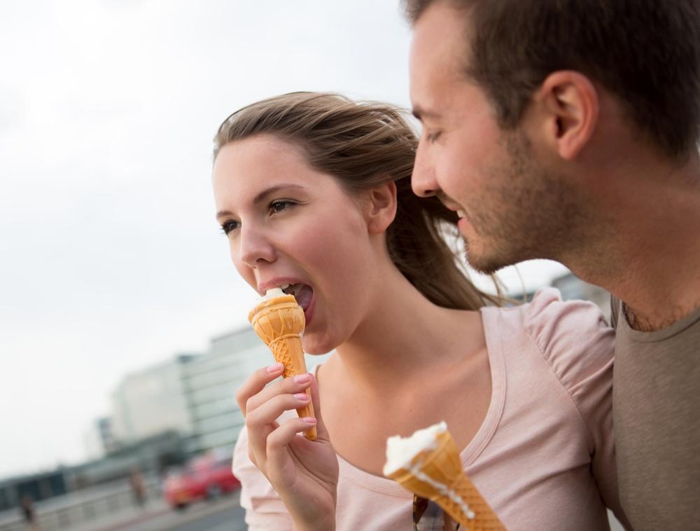 Happy couple enjoying an ice cream on a date.jpeg