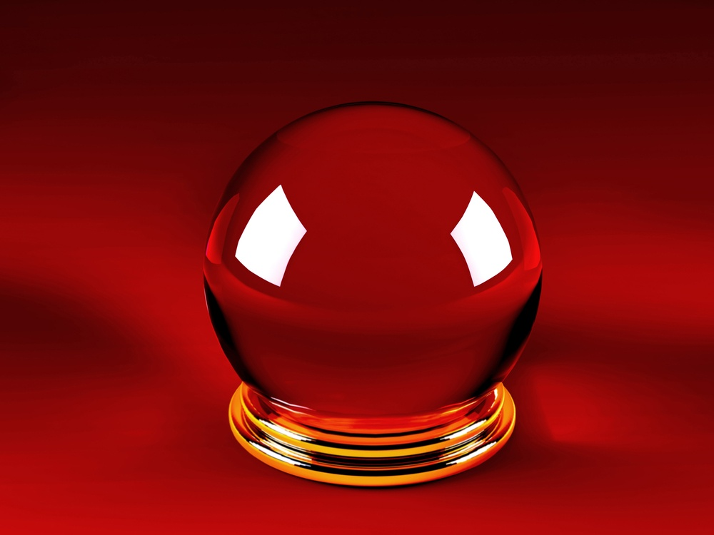 Magic crystal ball over a red background.jpeg