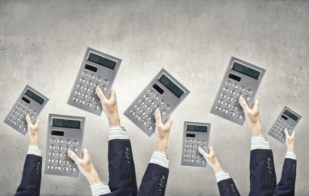 Many hands of business people holding calculators.jpeg