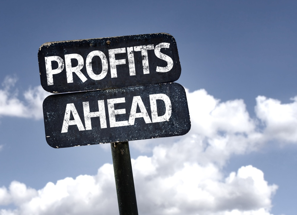 Profits Ahead sign with clouds and sky background-1.jpeg