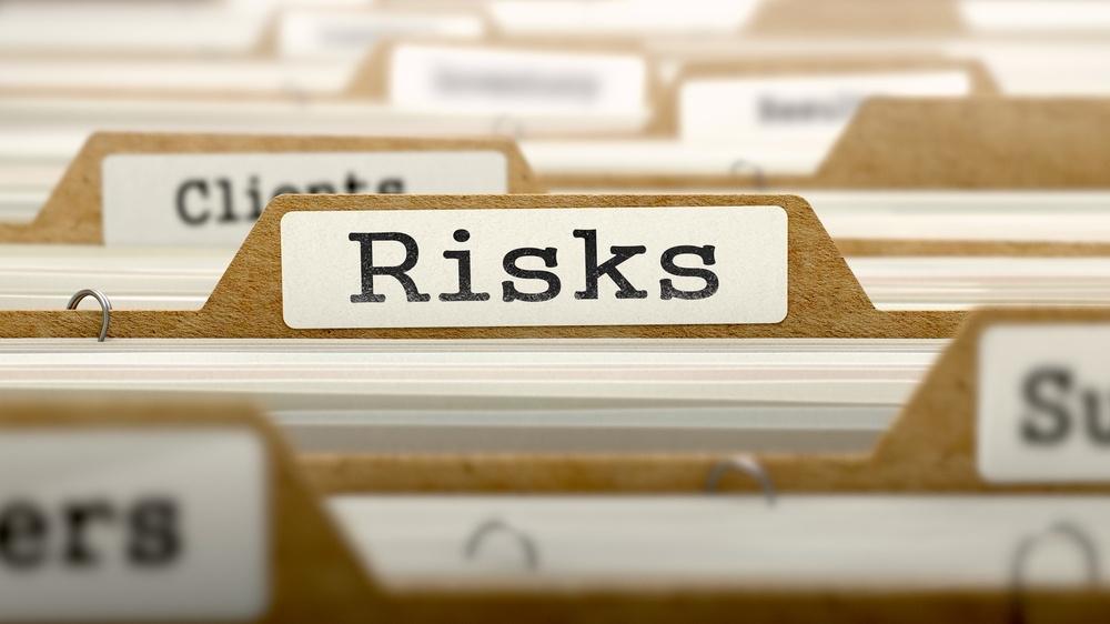 Risks Concept. Word on Folder Register of Card Index. Selective Focus..jpeg