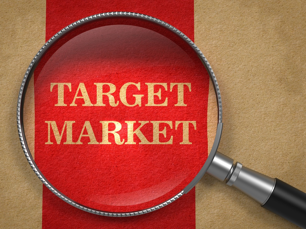 Target Market - Magnifying Glass on Old Paper with Red Vertical Line..jpeg