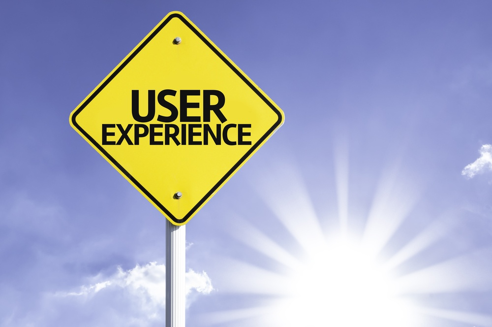 User Experience road sign with sun background.jpeg