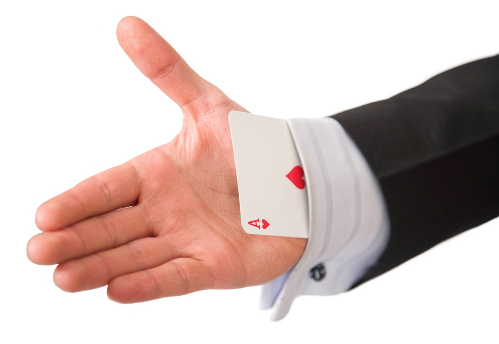 ace card held by business man.jpeg