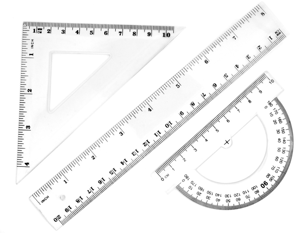 close up of different rulers and  school supplies on white background with clipping path.jpeg